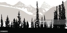 Treeline in silhouette with the front row being all black and snow covered mountain rages in the background in grey.
