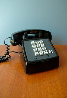 push button phone.....I have this in red!!!  It's my bat phone!