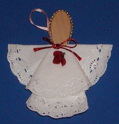 * Angel Ornament (and other easy Christmas Crafts for Children) Angel uses - 3 small paper doilies,  big flat wooden spoon,  string beads,  ribbon,  artificial flowers