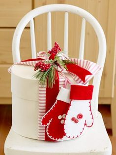"simple and beautiful ... use mitten ornaments as a way too decorate the gift and they become an additional ""gift""."