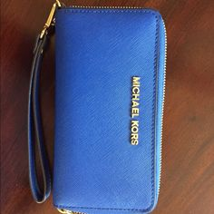 MK Wallet Blue leather zip around wallet with wristlet Michael Kors Bags Wallets