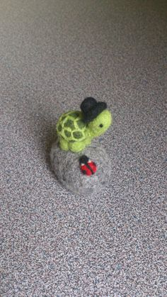 Miniature turtle with a high hat and ladybug on a rock needle felted ornament