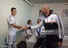 News Photo : Gareth Bale of Real Madrid shakes hands with...