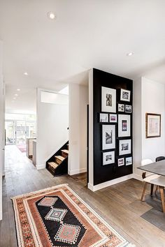 black paint accent wall/gallery wall/black frames/white mats/Dark, Moody Accent Walls with Photo Galleries
