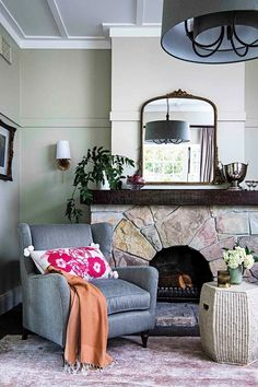 An opulent bouquet of colour, florals and foliage have breathed new life into this historic Sydney home Cosy Fireplace, Fireplace Surrounds, Orient House, French Country Collections, Wicker Coffee Table, Timber Table, Moroccan Theme, Wall Hung Vanity, Art Deco Mirror