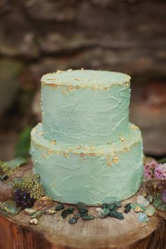A gorgeous wedding cake in frosty blue, flecked with edible gold leaf.