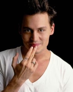 Johnny Depp licking his fingers