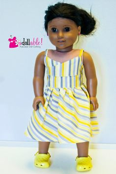 Yellow and gray striped wrap dress by AdollablebyRita on Etsy. Made using the Wrap Top Dress pattern, found at http://www.pixiefaire.com/products/wrap-top-dress-18-doll-clothes. #pixiefaire #wraptopdress