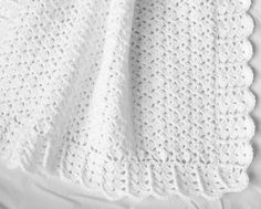 Handmade Lacy White Baby Blanket.  Measures 32 x 28 & is crocheted in a lacy shell pattern with a decorative border.  Made from 100% acrylic baby