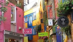 Pretty coloured buildings in London's Neal's Yard, a secret wonderland of shops and cafes.