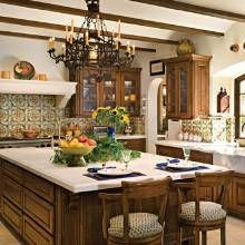 Hacienda home offers a kitchen with Old World ambience. Elements such as its beamed ceiling, deep-set window, wrought-iron chandelier, upper cabinets with glass doors, and backsplash of hand-painted Mexican clay.
