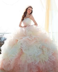This dreamy pastel gown from Kiyoko Hata featuring layers of colorful airy tulle is irresistible! Puffy Dresses, Quince Dresses, Ball Dresses, Cute Dresses, Rainbow Wedding Dress, Rainbow Dresses, Colored Wedding Gowns, Cocktail Bridesmaid Dresses, Pretty Quinceanera Dresses