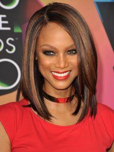 Tyra's ultra-sleek, shoulder-length caramel and auburn highlights