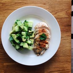 Chicken breast and avocado cucumber salad. 310 calories, 29g protein, 17g fat, 10g carbs.