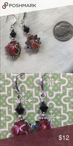Big heart ❤️ earrings! Great holiday gift 🎁!!!  Beautiful red Czech lampwork glass beads with heart shaped design.  Enhanced with black crystal bicones and sterling silver spacer rounds.  On sterling plated ear wires.  Handmade by me! Jewelry Earrings