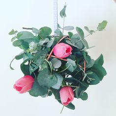 Decorating on a budget is simple! This design took 5 minutes using a decorative sphere from Kmart, eucalyptus collected on a walk with the kids and some faux tulips for colour. The result was baby shower perfect! Decorative Spheres, Market Baskets, Decorating On A Budget, Tulips, Make It Simple, Baby Shower, Colour, Plants, Kids