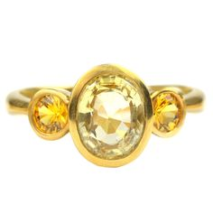 Yellow Sapphire and 22kt Gold Ring | From a unique collection of vintage fashion rings at https://www.1stdibs.com/jewelry/rings/fashion-rings/