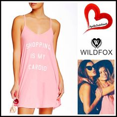 """❗️1-HOUR SALE❗️WILDFOX Coverup Slip Dress Mini WILDFOX Slip Dress 'Shopping Is My Cardio'  💟 NEW WITH TAGS 💟 RETAIL: $78  * A subtly relaxed fit & A-line silhouette  * Incredibly soft & comfortable  * Graphic detail on front; A texture that is purposely subtly distressed. * About 32.5"""" long   * A scoop neckline & thin straps  Fabric: 100% Cotton; Machine wash, Made in the USA Color: Neon Sign Pink Blush Item:95200 #  Pastel blush fuschia # Shirt dress 🚫 No Trades/PAYPAL🚫 ✅ Offers…"""