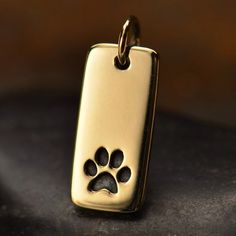 A personal favorite from my Etsy shop https://www.etsy.com/listing/293273127/natural-bronze-tag-with-paw-print-animal