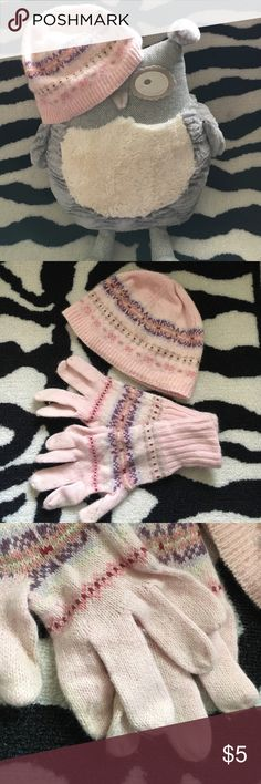 American Eagle beanie -- free matching gloves! American Eagle pink beanie. One size. Comes with matching gloves! Finger tips of gloves are a little dingy and have been washed but I have not tried oxyclean or any stronger stain removers. Not very noticeable but I like to dissolve everything. 20% angora (rabbit hair) which makes for a warm and cozy fabric but looks like dog/cat hair but I promise it's not!! This is a great set for any cold weather occasion! American Eagle Outfitters…