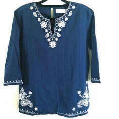 """Alfred Dunner Blue Cotton Embroidered Top Size 16 This Alfred Dunner Blue Cotton Embroidered Top is a Size 16 in good used condition. Beautiful blue 100% cotton fabric (no stretch) with pretty white stitching embroidery designs. Bust measures 23"""" across laying flat, measured from pit to pit, so 46"""" around. 28"""" long. ::: Bundle 3+ items from my closet and save 30% off when you use the app's Bundle feature! ::: No trades. Alfred Dunner Tops"""