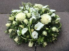 SYMPATHY Say goodbye to a loved one with a personal and thoughtful flower arrangement. The Broadway Florist will work with you to achieve this, incorporating elements that are meaningful to you both. POSY PADS Start from WREATH RINGS Funeral Floral Arrangements, White Flower Arrangements, Floral Centerpieces, Church Flowers, Funeral Flowers, Posy Flower, Funeral Sprays, Funeral Tributes, Memorial Flowers