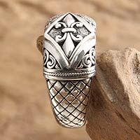 From Novica, Product ID 201734 on sale $52.19 An ornate fleur de lis crowns this elegant domed ring. By Kadek Hendra, this design is superbly crafted by hand.   .925 Sterling silver, 4mm width Artisan story card included with purchase.