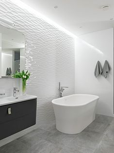 Fabulous Modern Alexandra Fedorova Integrated Loft Design in Russia: White Wave Pattern On The Walls Airy Apartment Moscow Bathroom Lit Up By The Hidden LED Lighting With A Bath Tub Near Corner