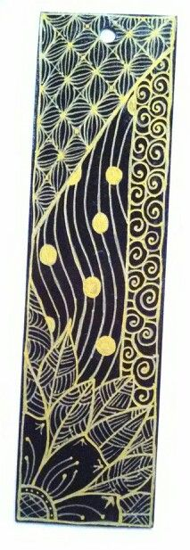 A #zentangle bookmark i made per my dads request for a friend. Black paper gold metallic pen with triple thick to gloss.