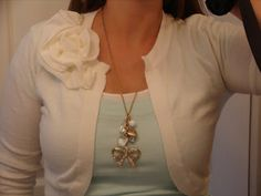 """Fabric Flower Sewing Tutorial: JCrew-inspired Rosette Cardigan, by Brittany on """"Little Inspirations"""" blog, 3 May 2010. Whether you have a mended spot that needs covering or you just want more shabby chic in your outfit (made with a pin back, this rosette could be detachable), this easy-to-make, ruffle trim flower may be just what you want."""