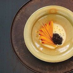 Hikori pumpkin cooked with katsuobushi (dried, fermented, and smoked tuna) and accompanied by koji butter sauce, cherry wood oil, salted and dried sakura, roasted kelp strips, and Japanese caviars by chef Rene Redzepi at the Noma pop-up in Tokyo, Japan. by: @little_meg_siu_meg #TheArtOfPlating