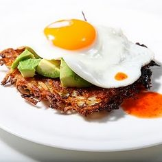 fried egg on top of avocado & hash browns