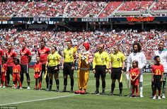 Ronald McDonald lines up alongside the two teams prior to kick-off in the International Champions Cup contest