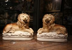 ANTIQUE STAFFORDSHIRE POTTERY PAIR OF SEATED LIONS