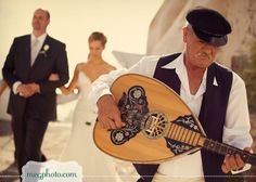 traditional greek musicians walk the bride and groom through town from the ceremony to the reception site.