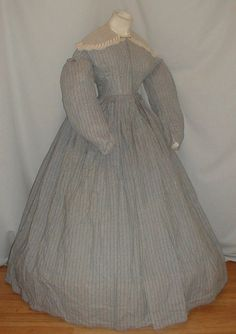 """Charming 1860's Civil War Gray White Cotton Print Dress   eBay seller fiddybee; fabtic has thin black line pattern; piping at neck, armscyes & waist; bodice ined in cotton & has front hook & eye closure; skirt attached with flat pleating & is unlined except band of cotton at hem; light underarm discoloration; net lace collar; bust: 36""""; waist: 28""""; skirt length: 41""""; hem width: 156"""""""