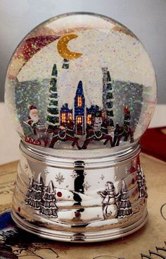 Silver-plated Christmas magic snowglobe