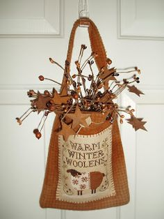 The World's Largest Collection of Smalls TOO: Little House Needleworks;  cute bag/door decoration