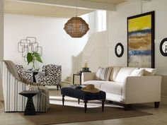The Hadley Sofa, Bardot Chair in striped fabric, The Janette Chair in black & white, and Talbot Ottoman all by Clayton Marcus.