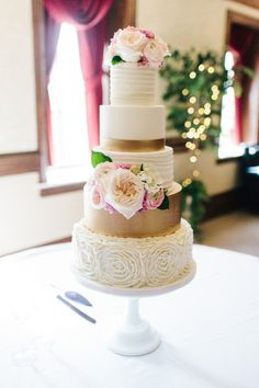 Elegant wedding cake idea - five-tiered wedding cake with gold layer, rosette-covered tier and pink floral cake topper {Sarah Libby Photography}