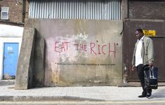 """""""Eat the Rich"""" by Banksy - London, 2009  1. Considering our discussions about """"food chains"""" and """"power,"""" what is the meaning of """"Eat the Rich""""?"""