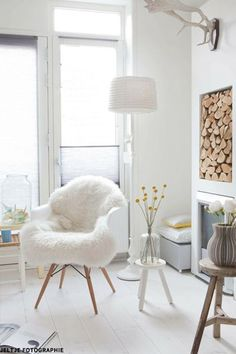 We draped a sheepskin over both Eames DAW armchairs for comfort and texture.