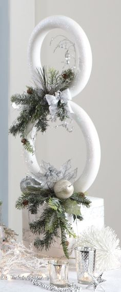 A great centerpiece for your holiday table. Snowman Sculpture - Uses a & extruded (smooth)foam wreaths and a cube plus various picks, etc Christmas Snowman, Winter Christmas, Christmas Holidays, Christmas Wreaths, Christmas Ornaments, Father Christmas, Christmas Wedding, Snowman Crafts, Christmas Projects