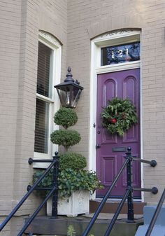 Can never go wrong with a purple door. The grey house color is similar to my home. :)