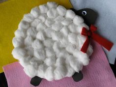 Adorable little lamb is made from a paper plate and cotton balls. Your little ones will have fun making this. #Crafts #Kids