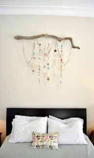 Bedroom sparkle - wall hanging made from strands of beads, seashells, chandelier prisms, buttons, pieces of jewelry hanging from a driftwood branch