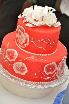 A red cake with flowers from an ICE student
