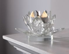 A gorgeous crystal tealight holder cut to precision in the shape of a Lotus flower. Suitable for use with tealight or dinner candles.