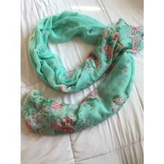 Oversized mint floral scarf/wrap More than just a scarf-- its huge. Can be used as a nursing cover for breastfeeding moms, scarf, beach cover up, wrap, the list goes on. Worn like once or twice! I just can't find many outfits to wear this with so its just taking up space for me. It's sheer, mint colored and with a floral design. Excellent condition. Forever 21 Accessories Scarves & Wraps