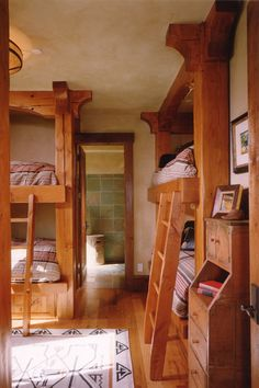 Bunk room. My Great Aunt Mary had a cottage in New York.  The attic had two rows of beds, separated by white curtains...to host endless friends and family.  I want that some day.